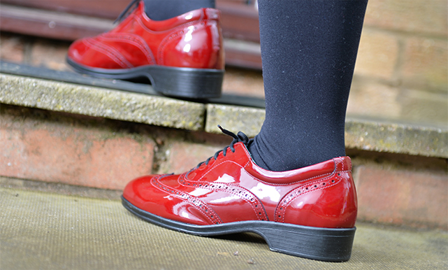 Close up of ladies red shoe walking up stairs